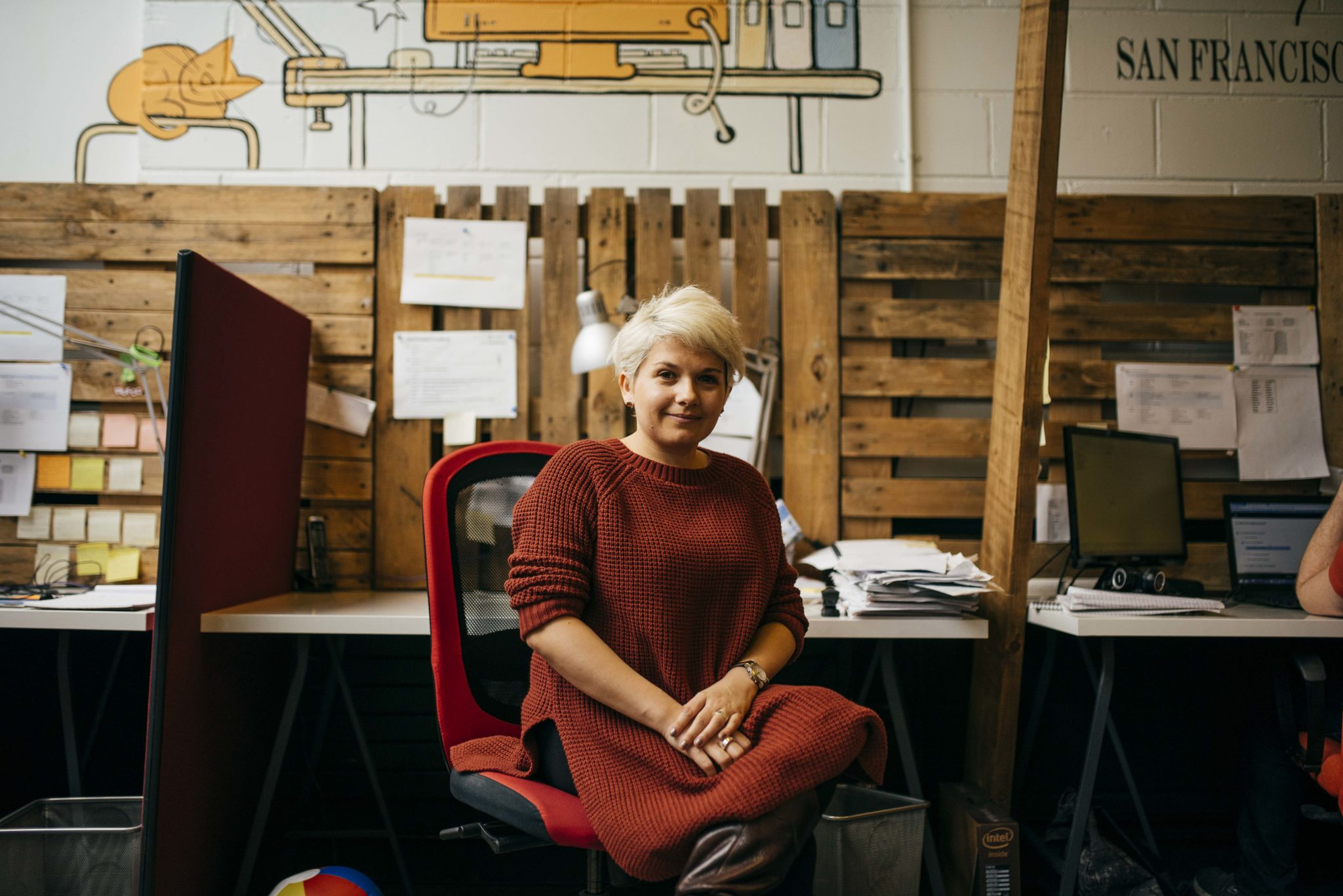 Kati, OnePageCRM sitting at her desk