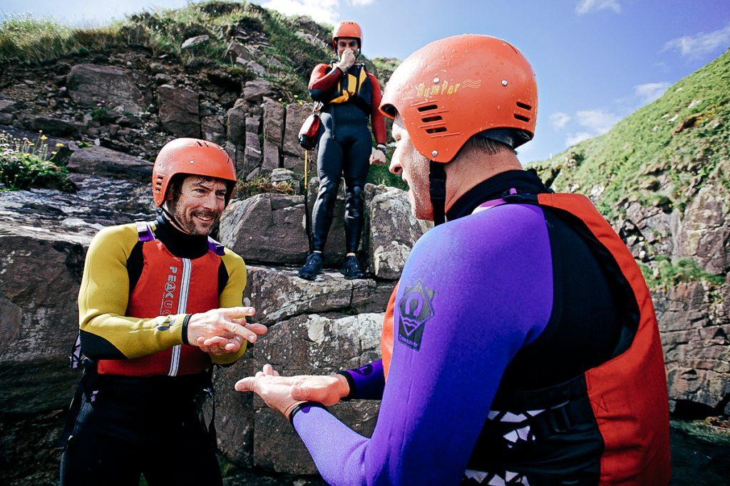 men cliff diving in Ireland